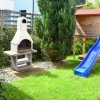 Apartment mit Spielplatz vorm Haus Playground for kids appartement austria tyrol